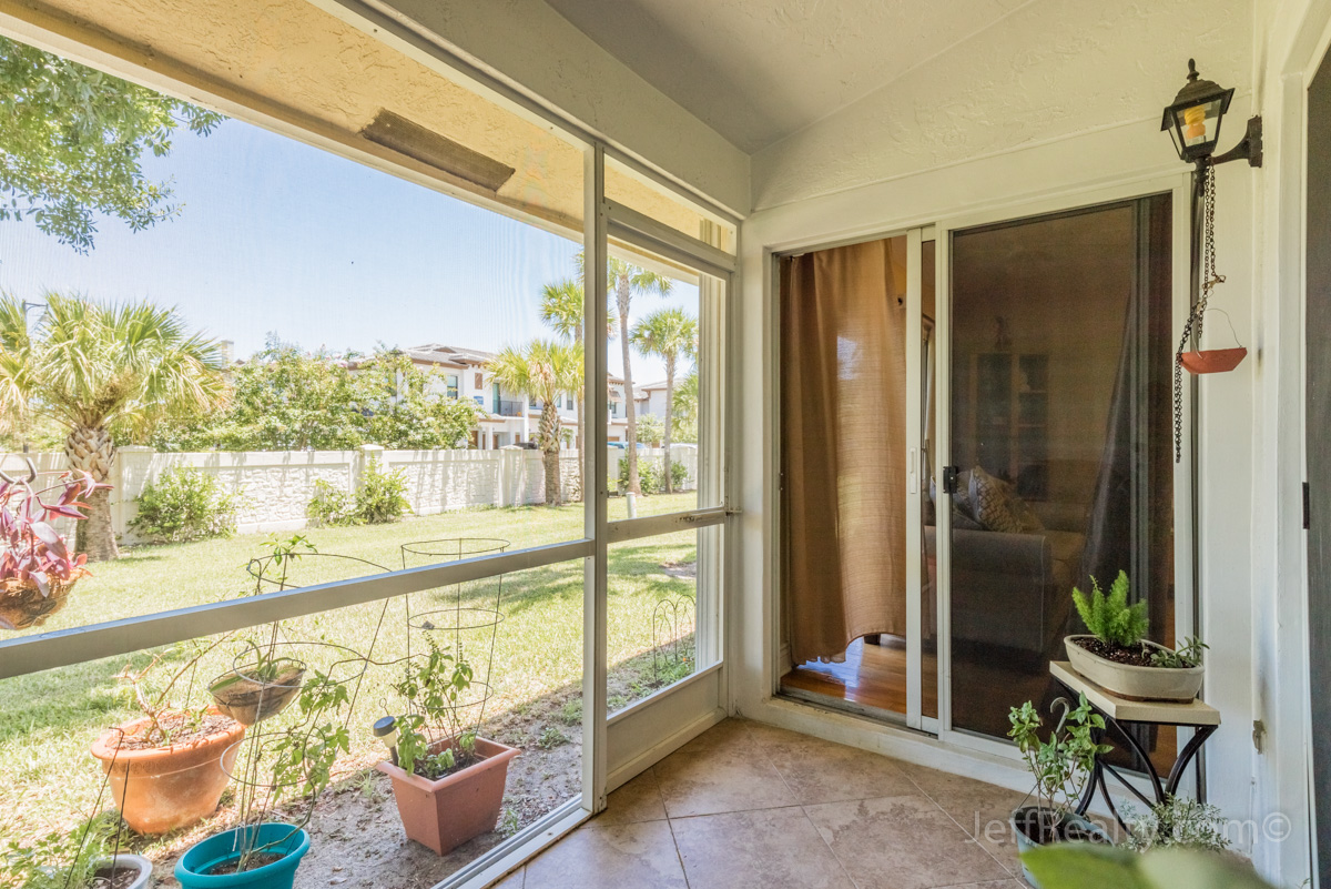 12824 Woodmill Drive | Screened Porch | Westwood Lakes | Palm Beach Gardens