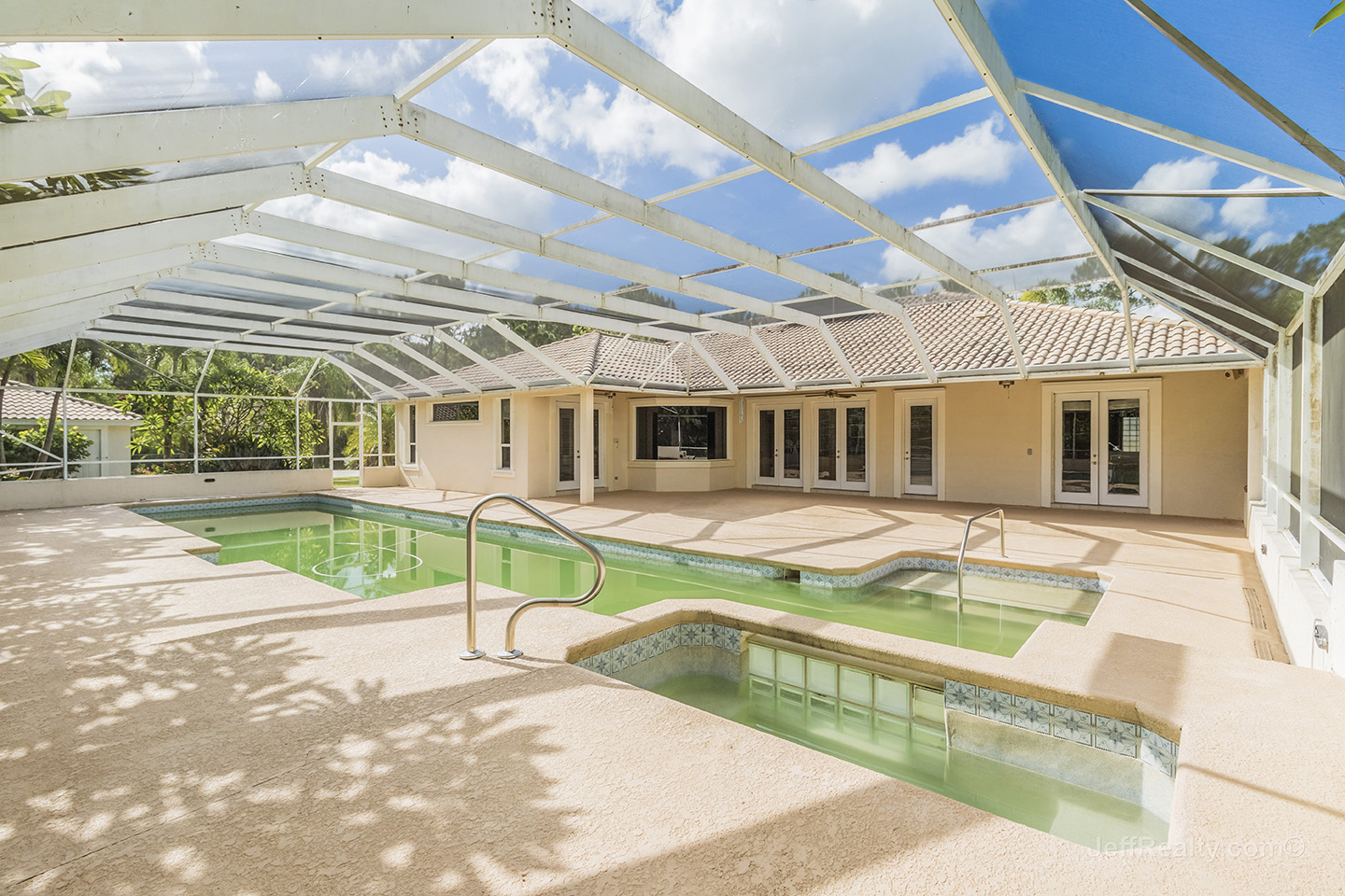 7821 159th Court N | Screened Swimming Pool & Spa | Palm Beach Country Estates | West Palm Beach
