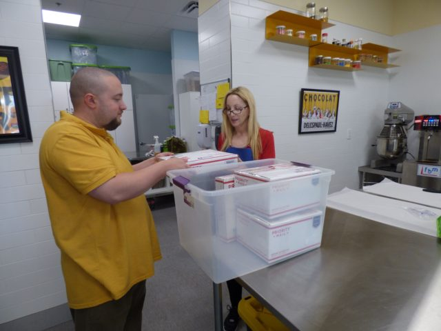 Valerie and Christian Prepare to Ship Orders
